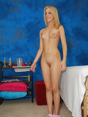 Skinny teenage blonde in jeans getting naked in the massage parlor