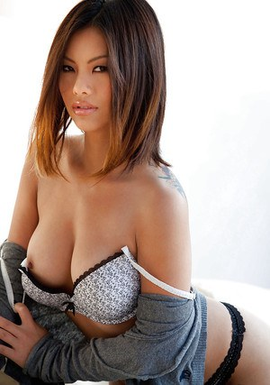 Asian sweetie revealing her tits with hard nipples and trimmed pussy