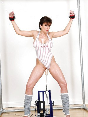 Bound up fetish lady in sport outfit has some fun with a fucking machine
