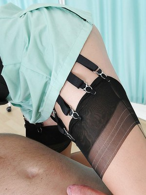 Mature femdom in stockings teasing and torturing her male pet's hard dick