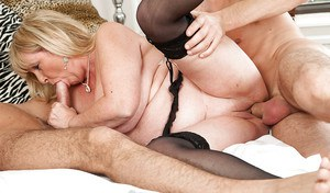 Fatty mature blonde has some double penetration fun with well-hung lads