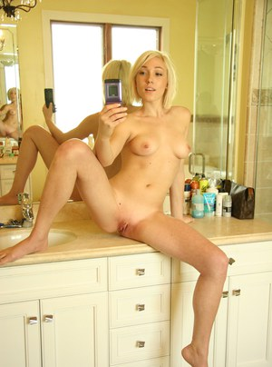Lovely amateur Lilly Lebeau getting naked and picturing herself