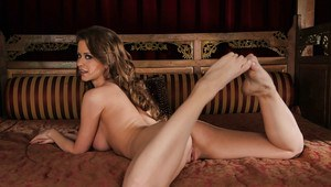 Gorgeous pornstar with long legs Emily Addison gets rid of her clothes