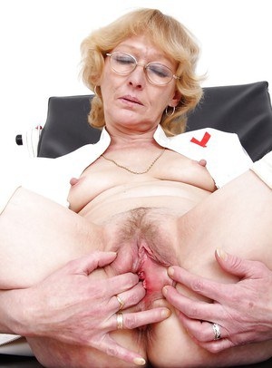 Sassy mature nurse taking off her panties and fingering her hungry twat