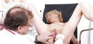 Mature blonde in glasses gets her pussy stuffed with toys and gyno tools