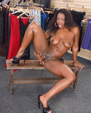 Curvaceous ebony lady getting naked and teasing her cunt with her fingers