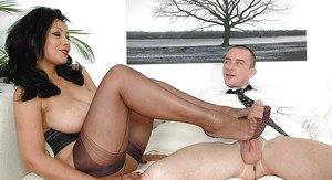 Big busted mature fetish lady in high-heeled shoes playing with a boner