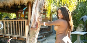 Ebony babe in jeans shorts Candice Nicole getting naked at the poolside