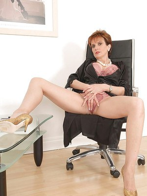 Leggy mature lady on high heels posing in silk night-gown and lingerie