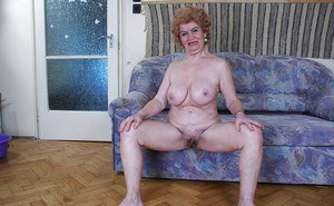 Lecherous granny with big jugs stripping and exposing her shaggy twat