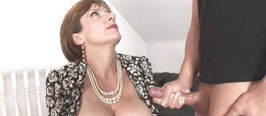Naughty mature lady gives some handjob pleasure to a younger lad