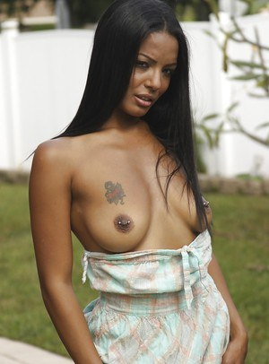 Adriana Milano getting naked and masturbating her cunt outdoor