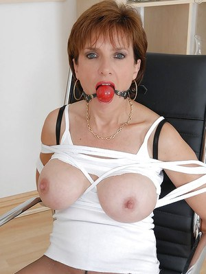 Tied up and ballgagged fetish lady in BDSM outfit is ready for rough action