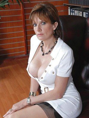 Desirable mature sex therapist in stockings flashing her hairy slit