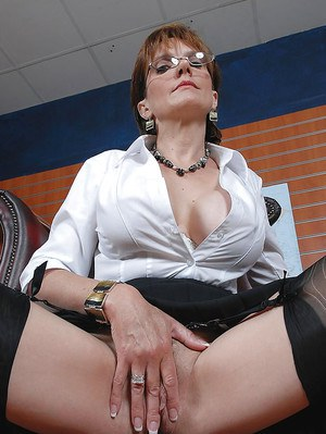 Mature fetish lady with no panties under her skirt spreading her pussy lips