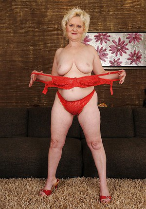 Curvy blonde granny with fatty ass gets rid of her lacy lingerie