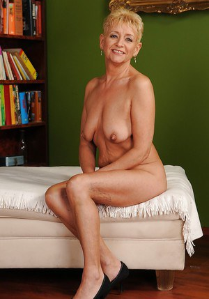 Smiley short-haired granny with ample ass gets rid of her clothes