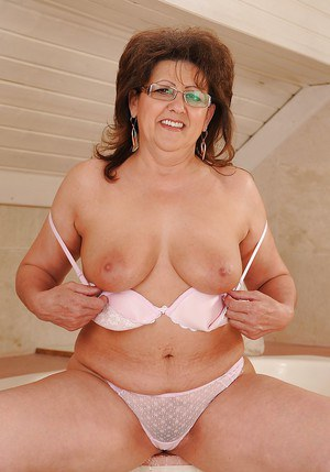 Salacious granny in glasses gets rid of her white lacy lingerie