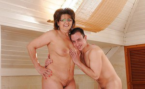 Sassy granny gets fucked and creampied by a younger lad in the bath
