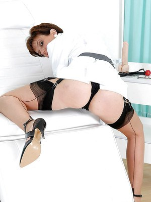 Mature fetish lady in stockings teasing her slit through her sexy panties