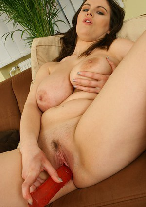 Top-heavy brunette MILF with ample ass playing with a dildo