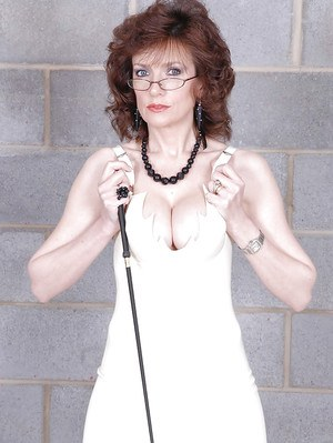 Mature fetish lady in glasses posing in tiny dress and pantyhose
