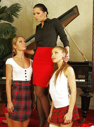 Seductive mistress has some strapon fun with her submissive girlfriends