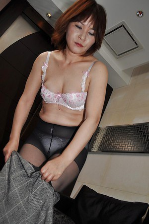 Frisky asian MILF Chiho Fujii getting naked and exposing her juicy slit