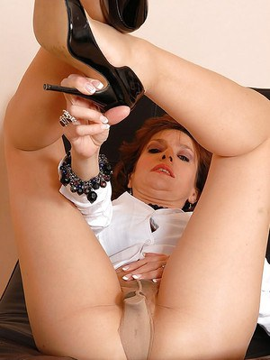 Mature fetish lady in nylon pantyhose playing with a vibrator