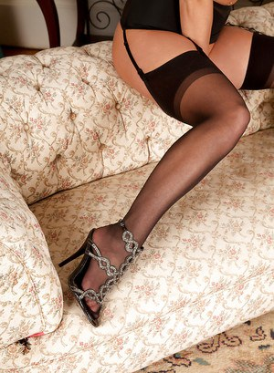 Steaming hot tattooed MILF in stockings striping and spreading her legs