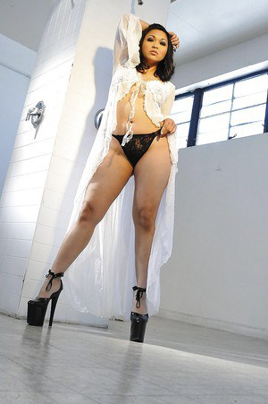 Asian vixen Mika Tan getting naked and teasing her twat with her fingers