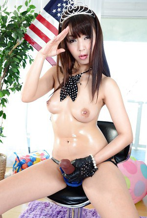 Naked asian hottie Marica Hase slipping on a strapon dildo