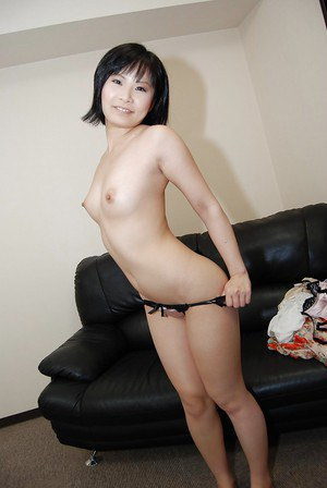 Asian babe Minori Nagakawa stripping down and exposing her hairy cunt