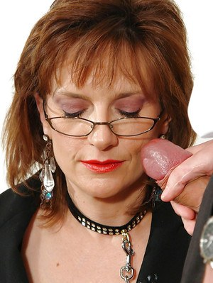 Kinky mature fetish lady gives head and takes a cumshot on her smiley face