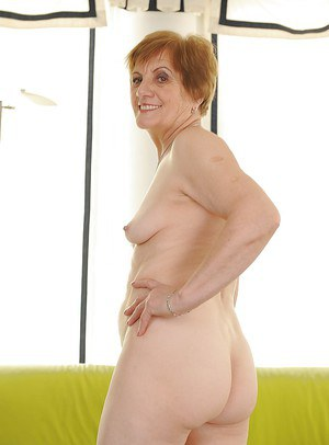 Playful granny with ample ass taking off her lingerie and spreading her legs