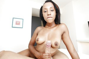 Frolic ebony babe pleasing a fat boner with her tongue and little hands
