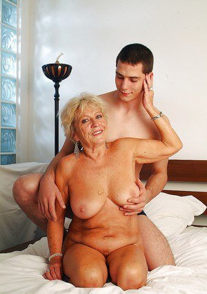 Lustful granny with massive jugs gets her hairy cunt pleased by a younger lad