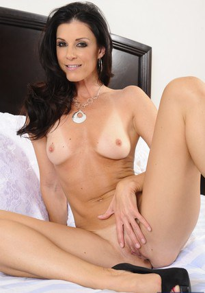 Well-graced MILF India Summer stripping down and fingering her pussy