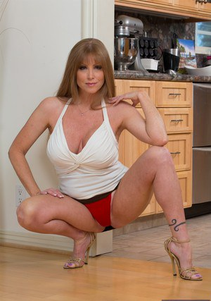 Curvaceous mature lady Darla Crane gets rid of her suit and panties
