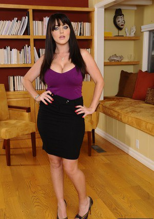 Curvy office babe Sophie Dee striping down and fingering her slit
