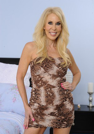 Smiley mature vixen Erica Lauren getting rid of her dress and panties