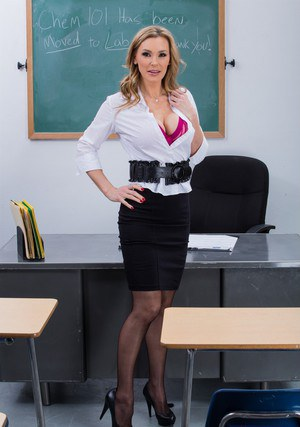 Sexy MILF Tanya Tate gets rid of her formal suit and reveals her big boobs