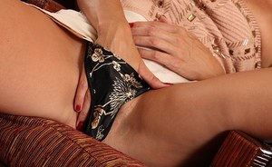 Chippy mature lady Misty Law slowly uncovering her tempting curves