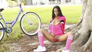 Tanned babe in pink socks Adriana Milano flashing her tits and pussy outdoor