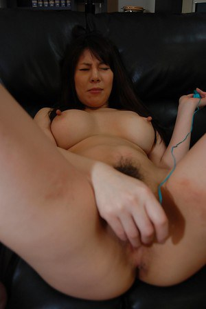 Top-heavy asian MILF Izumi Hori stripping down and toying her cunt