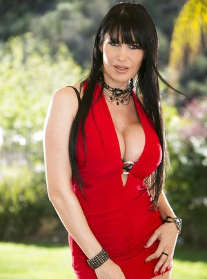 Bubbied european MILF gets rid of her red dress and sexy lingerie outdoor