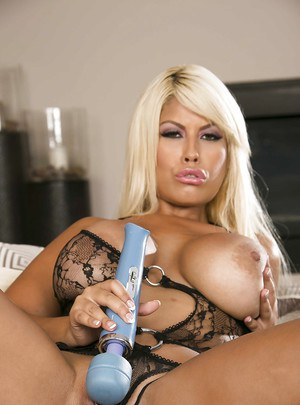 Cock-hungry pornstar in sexy lingerie masturbating her twat with sex toys