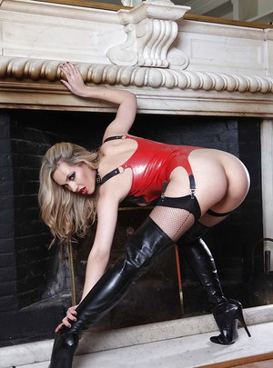 Svelte blonde fetish lady posing in provocative latex outfit