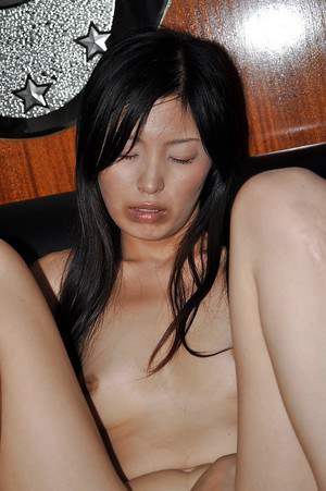 Asian MILF stripping down and has some pussy toying and fingering fun