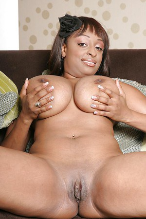 Ebony lassie with huge flabby jugs and bald slit posing naked